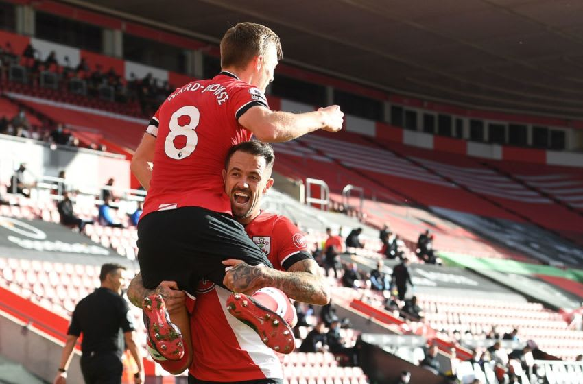 Southampton's English midfielder James Ward-Prowse (L) celebrates with Southampton's English striker Danny Ings after scoring the opening goal during the English Premier League football match between Southampton and Everton at St Mary's Stadium in Southampton, southern England, on October 25, 2020. (Photo by Andy Rain / various sources / AFP) / RESTRICTED TO EDITORIAL USE. No use with unauthorized audio, video, data, fixture lists, club/league logos or 'live' services. Online in-match use limited to 120 images. An additional 40 images may be used in extra time. No video emulation. Social media in-match use limited to 120 images. An additional 40 images may be used in extra time. No use in betting publications, games or single club/league/player publications. / (Photo by ANDY RAIN/AFP via Getty Images)