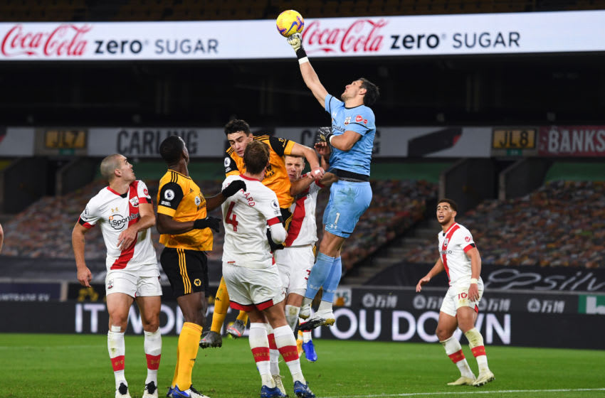 WOLVERHAMPTON, ENGLAND - NOVEMBER 23: Alex McCarthy of Southampton with Coca Cola Zero sugar advert in background during the Premier League match between Wolverhampton Wanderers and Southampton at Molineux on November 23, 2020 in Wolverhampton, United Kingdom. Sporting stadiums around the UK remain under strict restrictions due to the Coronavirus Pandemic as Government social distancing laws prohibit fans inside venues resulting in games being played behind closed doors. (Photo by Sam Bagnall - AMA/Getty Images)