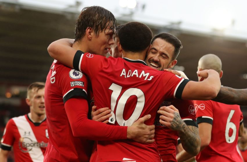Southampton's English midfielder Che Adams (C) celebrates with Southampton's Danish defender Jannik Vestergaard (L) and Southampton's English striker Danny Ings (2nd R) after scoring the opening goal of the English Premier League football match between Southampton and Sheffield United at St Mary's Stadium in Southampton, southern England on December 13, 2020. (Photo by Naomi Baker / POOL / AFP) / RESTRICTED TO EDITORIAL USE. No use with unauthorized audio, video, data, fixture lists, club/league logos or 'live' services. Online in-match use limited to 120 images. An additional 40 images may be used in extra time. No video emulation. Social media in-match use limited to 120 images. An additional 40 images may be used in extra time. No use in betting publications, games or single club/league/player publications. / (Photo by NAOMI BAKER/POOL/AFP via Getty Images)