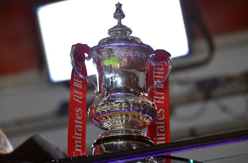 The FA Cup trophy is seen in the TV studio ahead of the English FA Cup third round football match between Arsenal and Newcastle United at the Emirates Stadium in London on January 9, 2021. (Photo by Glyn KIRK / AFP) / RESTRICTED TO EDITORIAL USE. No use with unauthorized audio, video, data, fixture lists, club/league logos or 'live' services. Online in-match use limited to 120 images. An additional 40 images may be used in extra time. No video emulation. Social media in-match use limited to 120 images. An additional 40 images may be used in extra time. No use in betting publications, games or single club/league/player publications. / (Photo by GLYN KIRK/AFP via Getty Images)