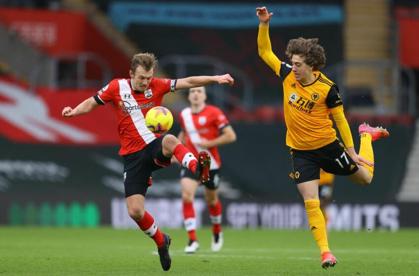 Southampton's English midfielder James Ward-Prowse (L) vies with Wolverhampton Wanderers' Portuguese striker Fabio Silva (R) during the English Premier League football match between Southampton and Wolverhampton Wanderers at St Mary's Stadium in Southampton, southern England on February 14, 2021. (Photo by Richard Heathcote / POOL / AFP) / RESTRICTED TO EDITORIAL USE. No use with unauthorized audio, video, data, fixture lists, club/league logos or 'live' services. Online in-match use limited to 120 images. An additional 40 images may be used in extra time. No video emulation. Social media in-match use limited to 120 images. An additional 40 images may be used in extra time. No use in betting publications, games or single club/league/player publications. / (Photo by RICHARD HEATHCOTE/POOL/AFP via Getty Images)