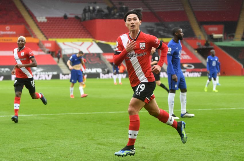 Southampton's Japanese midfielder Takumi Minamino celebrates scoring his team's first goal during the English Premier League football match between Southampton and Chelsea at St Mary's Stadium in Southampton, southern England on February 20, 2021. (Photo by NEIL HALL / POOL / AFP) / RESTRICTED TO EDITORIAL USE. No use with unauthorized audio, video, data, fixture lists, club/league logos or 'live' services. Online in-match use limited to 120 images. An additional 40 images may be used in extra time. No video emulation. Social media in-match use limited to 120 images. An additional 40 images may be used in extra time. No use in betting publications, games or single club/league/player publications. / (Photo by NEIL HALL/POOL/AFP via Getty Images)