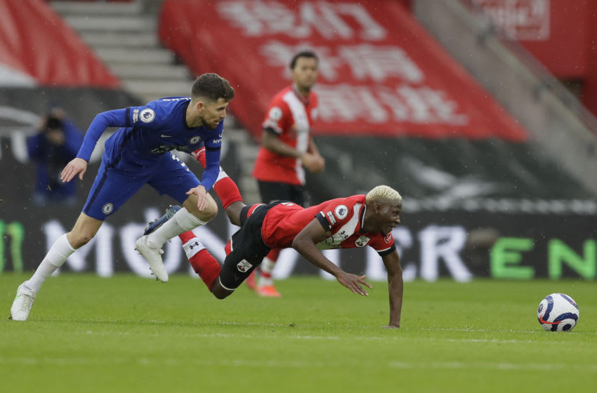 Chelsea's Italian midfielder Jorginho (L) vies with Southampton's Malian midfielder Moussa Djenepo during the English Premier League football match between Southampton and Chelsea at St Mary's Stadium in Southampton, southern England on February 20, 2021. (Photo by Kirsty Wigglesworth / POOL / AFP) / RESTRICTED TO EDITORIAL USE. No use with unauthorized audio, video, data, fixture lists, club/league logos or 'live' services. Online in-match use limited to 120 images. An additional 40 images may be used in extra time. No video emulation. Social media in-match use limited to 120 images. An additional 40 images may be used in extra time. No use in betting publications, games or single club/league/player publications. / (Photo by KIRSTY WIGGLESWORTH/POOL/AFP via Getty Images)