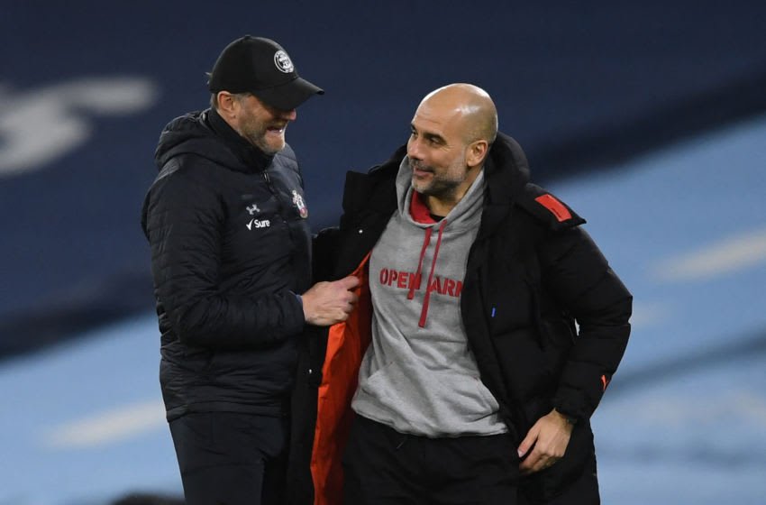 Manchester City's Spanish manager Pep Guardiola (R) and Southampton's Austrian manager Ralph Hasenhuttl chat at the final whistle during the English Premier League football match between Manchester City and Southampton at the Etihad Stadium in Manchester, north west England on March 10, 2021. - RESTRICTED TO EDITORIAL USE. No use with unauthorized audio, video, data, fixture lists, club/league logos or 'live' services. Online in-match use limited to 120 images. An additional 40 images may be used in extra time. No video emulation. Social media in-match use limited to 120 images. An additional 40 images may be used in extra time. No use in betting publications, games or single club/league/player publications. (Photo by Gareth Copley / POOL / AFP) / RESTRICTED TO EDITORIAL USE. No use with unauthorized audio, video, data, fixture lists, club/league logos or 'live' services. Online in-match use limited to 120 images. An additional 40 images may be used in extra time. No video emulation. Social media in-match use limited to 120 images. An additional 40 images may be used in extra time. No use in betting publications, games or single club/league/player publications. / RESTRICTED TO EDITORIAL USE. No use with unauthorized audio, video, data, fixture lists, club/league logos or 'live' services. Online in-match use limited to 120 images. An additional 40 images may be used in extra time. No video emulation. Social media in-match use limited to 120 images. An additional 40 images may be used in extra time. No use in betting publications, games or single club/league/player publications. (Photo by GARETH COPLEY/POOL/AFP via Getty Images)