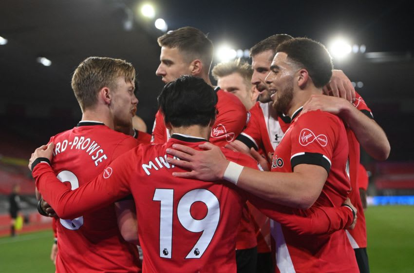 Southampton's English midfielder James Ward-Prowse (L) celebrates with teammates after scoring the opening goal from the penalty spot during the English Premier League football match between Southampton and Leicester City at St Mary's Stadium in Southampton, southern England on April 30, 2021. - RESTRICTED TO EDITORIAL USE. No use with unauthorized audio, video, data, fixture lists, club/league logos or 'live' services. Online in-match use limited to 120 images. An additional 40 images may be used in extra time. No video emulation. Social media in-match use limited to 120 images. An additional 40 images may be used in extra time. No use in betting publications, games or single club/league/player publications. (Photo by NEIL HALL / POOL / AFP) / RESTRICTED TO EDITORIAL USE. No use with unauthorized audio, video, data, fixture lists, club/league logos or 'live' services. Online in-match use limited to 120 images. An additional 40 images may be used in extra time. No video emulation. Social media in-match use limited to 120 images. An additional 40 images may be used in extra time. No use in betting publications, games or single club/league/player publications. / RESTRICTED TO EDITORIAL USE. No use with unauthorized audio, video, data, fixture lists, club/league logos or 'live' services. Online in-match use limited to 120 images. An additional 40 images may be used in extra time. No video emulation. Social media in-match use limited to 120 images. An additional 40 images may be used in extra time. No use in betting publications, games or single club/league/player publications. (Photo by NEIL HALL/POOL/AFP via Getty Images)