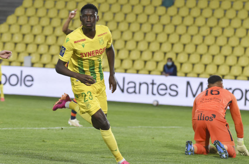 Nantes' French forward Randal Kolo Muani celebrates scoring his team's first goal during the French L1 football match between Nantes (FC Nantes) and Montpellier Herault SC at La Beaujoire Stadium in Nantes, western France on May 23, 2021. (Photo by Sebastien SALOM-GOMIS / AFP) (Photo by SEBASTIEN SALOM-GOMIS/AFP via Getty Images)