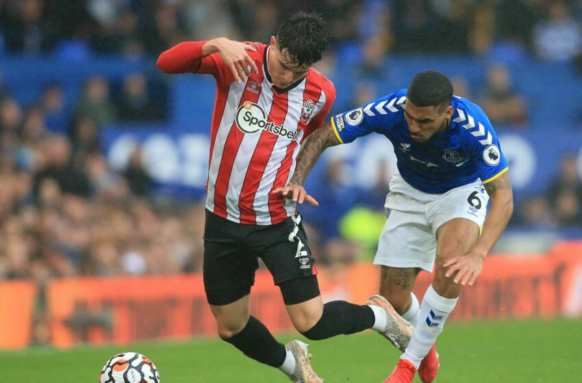 Everton's Brazilian midfielder Allan (R) vies with Southampton's English defender Tino Livramento during the English Premier League football match between Everton and Southampton at Goodison Park in Liverpool, north west England on August 14, 2021. - RESTRICTED TO EDITORIAL USE. No use with unauthorized audio, video, data, fixture lists, club/league logos or 'live' services. Online in-match use limited to 120 images. An additional 40 images may be used in extra time. No video emulation. Social media in-match use limited to 120 images. An additional 40 images may be used in extra time. No use in betting publications, games or single club/league/player publications. (Photo by Lindsey Parnaby / AFP) / RESTRICTED TO EDITORIAL USE. No use with unauthorized audio, video, data, fixture lists, club/league logos or 'live' services. Online in-match use limited to 120 images. An additional 40 images may be used in extra time. No video emulation. Social media in-match use limited to 120 images. An additional 40 images may be used in extra time. No use in betting publications, games or single club/league/player publications. / RESTRICTED TO EDITORIAL USE. No use with unauthorized audio, video, data, fixture lists, club/league logos or 'live' services. Online in-match use limited to 120 images. An additional 40 images may be used in extra time. No video emulation. Social media in-match use limited to 120 images. An additional 40 images may be used in extra time. No use in betting publications, games or single club/league/player publications. (Photo by LINDSEY PARNABY/AFP via Getty Images)