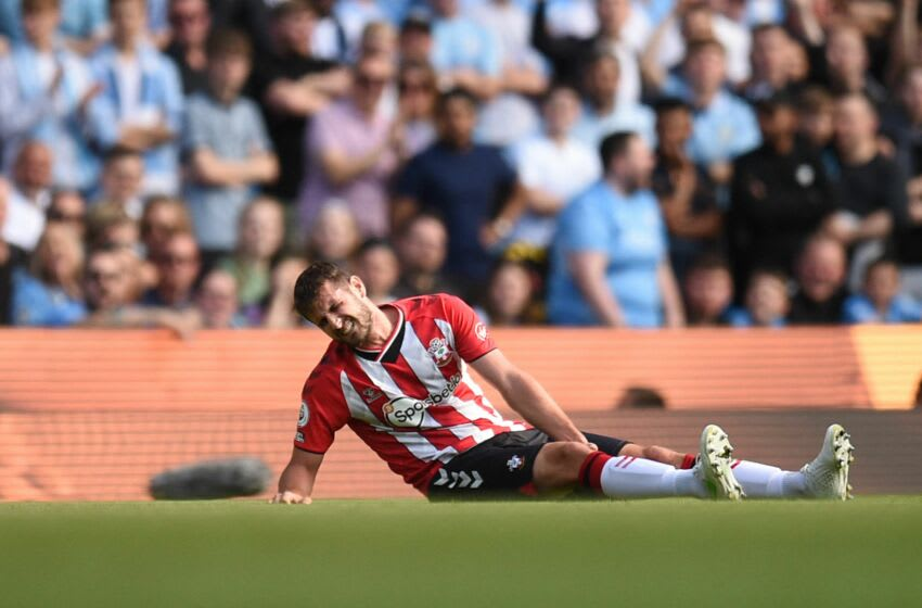 Southampton's English defender Jack Stephens holds his leg during the English Premier League football match between Manchester City and Southampton at the Etihad Stadium in Manchester, north west England, on September 18, 2021. - RESTRICTED TO EDITORIAL USE. No use with unauthorized audio, video, data, fixture lists, club/league logos or 'live' services. Online in-match use limited to 120 images. An additional 40 images may be used in extra time. No video emulation. Social media in-match use limited to 120 images. An additional 40 images may be used in extra time. No use in betting publications, games or single club/league/player publications. (Photo by Oli SCARFF / AFP) / RESTRICTED TO EDITORIAL USE. No use with unauthorized audio, video, data, fixture lists, club/league logos or 'live' services. Online in-match use limited to 120 images. An additional 40 images may be used in extra time. No video emulation. Social media in-match use limited to 120 images. An additional 40 images may be used in extra time. No use in betting publications, games or single club/league/player publications. / RESTRICTED TO EDITORIAL USE. No use with unauthorized audio, video, data, fixture lists, club/league logos or 'live' services. Online in-match use limited to 120 images. An additional 40 images may be used in extra time. No video emulation. Social media in-match use limited to 120 images. An additional 40 images may be used in extra time. No use in betting publications, games or single club/league/player publications. (Photo by OLI SCARFF/AFP via Getty Images)