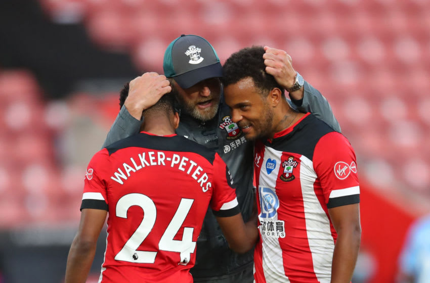SOUTHAMPTON, ENGLAND - JULY 05: Ralph Hasenhuttle, Manager of Southampton, Kyle Walker-Peters, and Ryan Bertrand of Southampton celebrate following their team's victory in the Premier League match between Southampton FC and Manchester City at St Mary's Stadium on July 05, 2020 in Southampton, England. Football Stadiums around Europe remain empty due to the Coronavirus Pandemic as Government social distancing laws prohibit fans inside venues resulting in games being played behind closed doors. (Photo by Catherine Ivill/Getty Images)