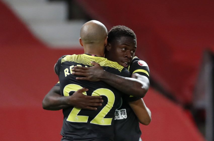 MANCHESTER, ENGLAND - JULY 13: Michael Obafemi of Southampton celebrates with teammate Nathan Redmond of Southampton after scoring his team's second goal during the Premier League match between Manchester United and Southampton FC at Old Trafford on July 13, 2020 in Manchester, England. Football Stadiums around Europe remain empty due to the Coronavirus Pandemic as Government social distancing laws prohibit fans inside venues resulting in all fixtures being played behind closed doors. (Photo by Clive Brunskill/Getty Images)