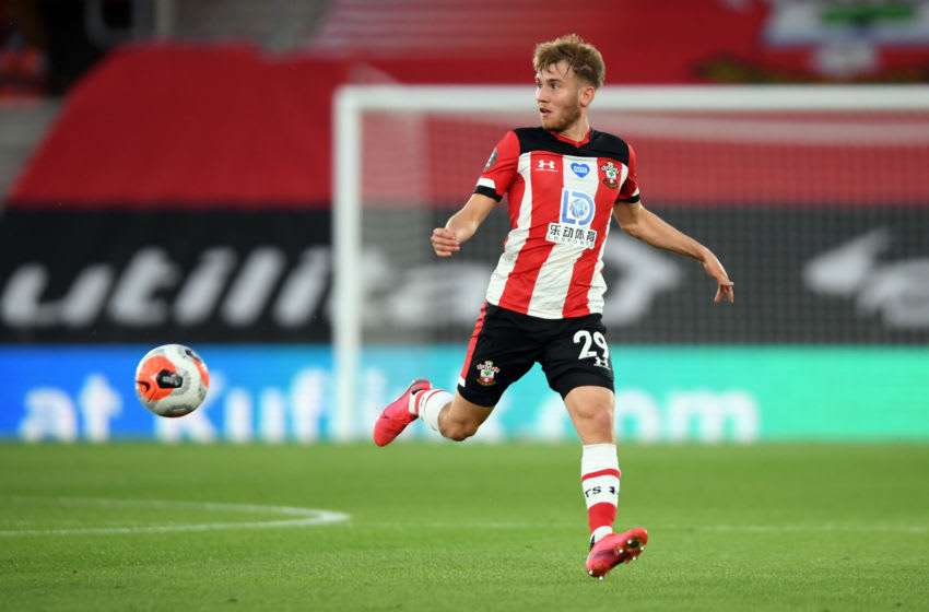SOUTHAMPTON, ENGLAND - JULY 16: Jake Vokins of Southampton during the Premier League match between Southampton FC and Brighton & Hove Albion at St Mary's Stadium on July 16, 2020 in Southampton, England. Football Stadiums around Europe remain empty due to the Coronavirus Pandemic as Government social distancing laws prohibit fans inside venues resulting in all fixtures being played behind closed doors. (Photo by Mike Hewitt/Getty Images)
