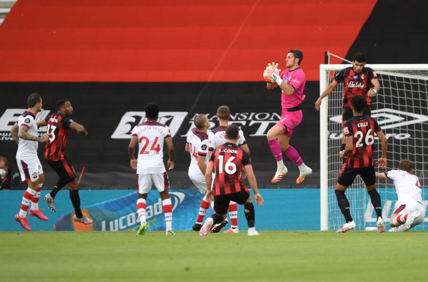 BOURNEMOUTH, ENGLAND - JULY 19: Alex McCarthy of Southampton attempts to make a save as a banner in the background reads 'Eddie had a dream' during the Premier League match between AFC Bournemouth and Southampton FC at Vitality Stadium on July 19, 2020 in Bournemouth, England. Football Stadiums around Europe remain empty due to the Coronavirus Pandemic as Government social distancing laws prohibit fans inside venues resulting in all fixtures being played behind closed doors. (Photo by Mike Hewitt/Getty Images)