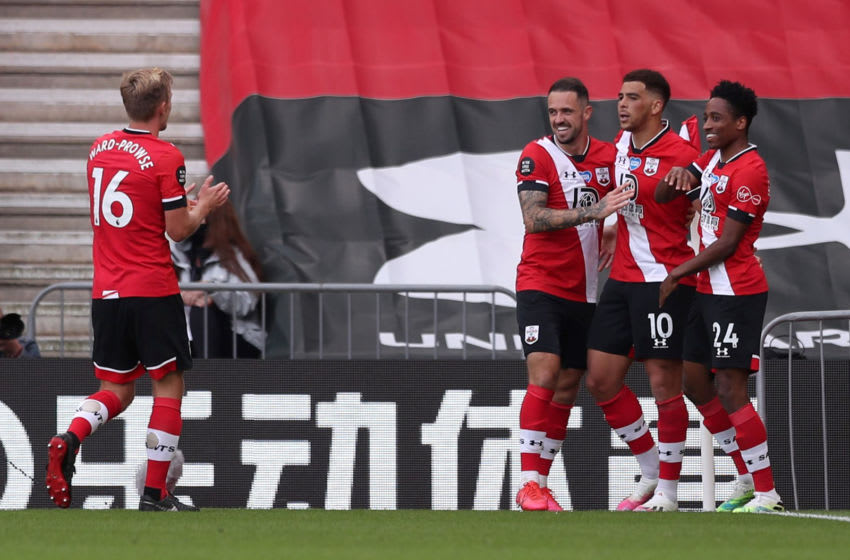SOUTHAMPTON, ENGLAND - JULY 26: Che Adams of Southampton celebrates with teammates Danny Ings, Kyle Walker-Peters and James Ward-Prowse after scoring his team's first goal during the Premier League match between Southampton FC and Sheffield United at St Mary's Stadium on July 26, 2020 in Southampton, England. Football Stadiums around Europe remain empty due to the Coronavirus Pandemic as Government social distancing laws prohibit fans inside venues resulting in all fixtures being played behind closed doors. (Photo by Naomi Baker/Getty Images)