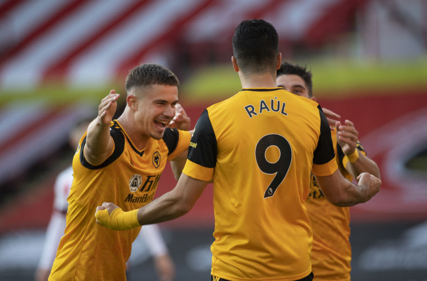 SHEFFIELD, ENGLAND - SEPTEMBER 14: Raul Jimenez of Wolverhampton Wanderer celebrates scoring the first goal with team mates Leander Dendoncker and Pedro Neto during the Premier League match between Sheffield United and Wolverhampton Wanderers at Bramall Lane on September 14, 2020 in Sheffield, United Kingdom. (Photo by Visionhaus)