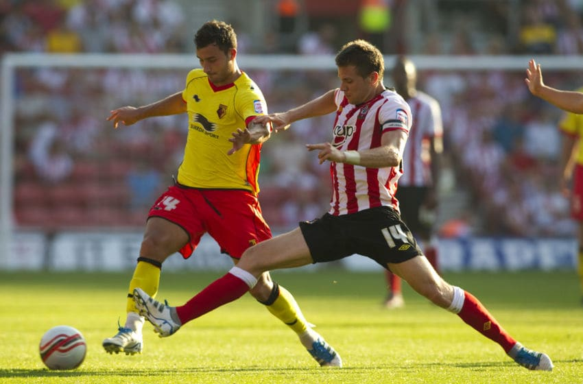 SOUTHAMPTON, ENGLAND - OCTOBER 1: Dean Hammond of Southampton tackles Ross Jenkins of Watford during the npower Championship match between Southampton and Watford at St. Marys Stadium on October 1, 2011 in Southampton, England. (Photo by Ben Hoskins/Getty Images)