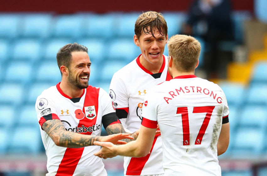 BIRMINGHAM, ENGLAND - NOVEMBER 01: Danny Ings of Southampton celebrates with teammates Jannik Vestergaard and Stuart Armstrong after scoring his team's fourth goal during the Premier League match between Aston Villa and Southampton at Villa Park on November 01, 2020 in Birmingham, England. Sporting stadiums around the UK remain under strict restrictions due to the Coronavirus Pandemic as Government social distancing laws prohibit fans inside venues resulting in games being played behind closed doors. (Photo by Michael Steele/Getty Images)