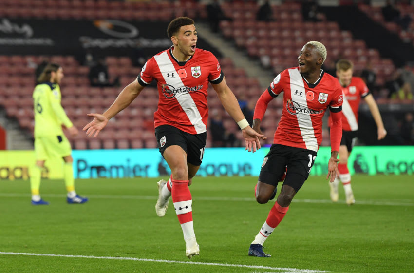 SOUTHAMPTON, ENGLAND - NOVEMBER 06: Southampton player Che Adams celebrates his opening goal with Moussa Djenepo (r) during the Premier League match between Southampton and Newcastle United at St Mary's Stadium on November 06, 2020 in Southampton, England. Sporting stadiums around the UK remain under strict restrictions due to the Coronavirus Pandemic as Government social distancing laws prohibit fans inside venues resulting in games being played behind closed doors. (Photo by Stu Forster/Getty Images)