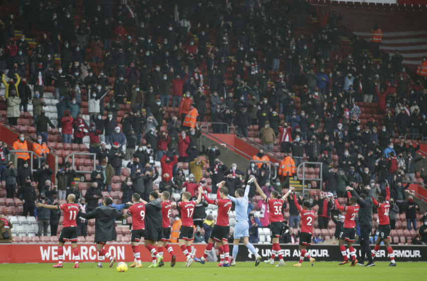 SOUTHAMPTON, ENGLAND - DECEMBER 13: Southampton team acknowledge return of a limited number of home fans after their 3-0 win during the Premier League match between Southampton and Sheffield United at St Mary's Stadium on December 13, 2020 in Southampton, England. A limited number of spectators (2000) are welcomed back to stadiums to watch elite football across England. This was following easing of restrictions on spectators in tiers one and two areas only. (Photo by Robin Jones/Getty Images)