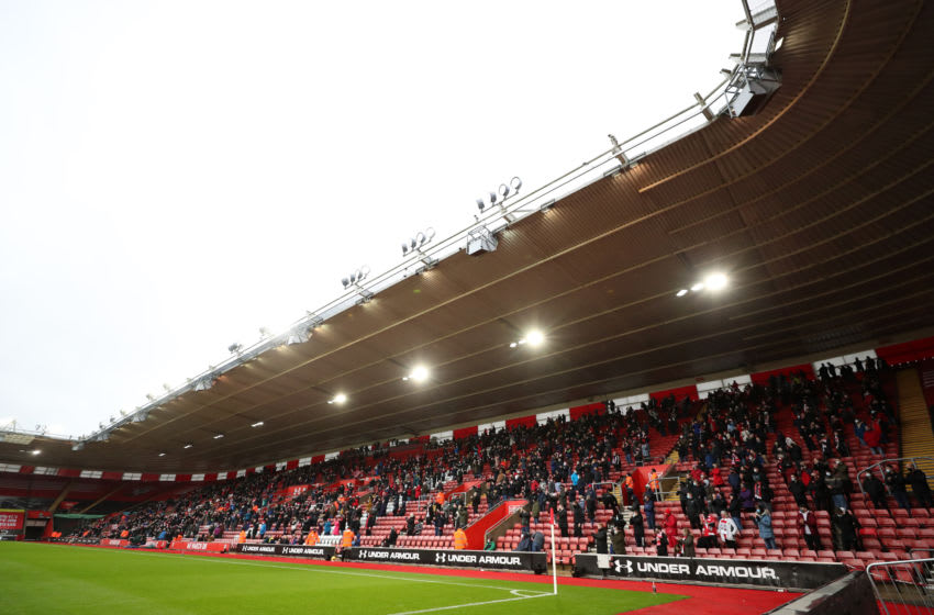 SOUTHAMPTON, ENGLAND - DECEMBER 13: General view inside the stadium as fans take their seats inside the stadium socially distanced and wearing face masks during the Premier League match between Southampton and Sheffield United at St Mary's Stadium on December 13, 2020 in Southampton, England. A limited number of spectators (2000) are welcomed back to stadiums to watch elite football across England. This was following easing of restrictions on spectators in tiers one and two areas only. (Photo by Naomi Baker/Getty Images)