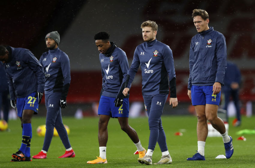 LONDON, ENGLAND - DECEMBER 16: Kyle Walker-Peters, Stuart Armstrong and Jannik Vestergaard of Southampton warm up prior to the Premier League match between Arsenal and Southampton at Emirates Stadium on December 16, 2020 in London, England. The match will be played without fans, behind closed doors as a Covid-19 precaution. (Photo by Adrian Dennis - Pool/Getty Images)