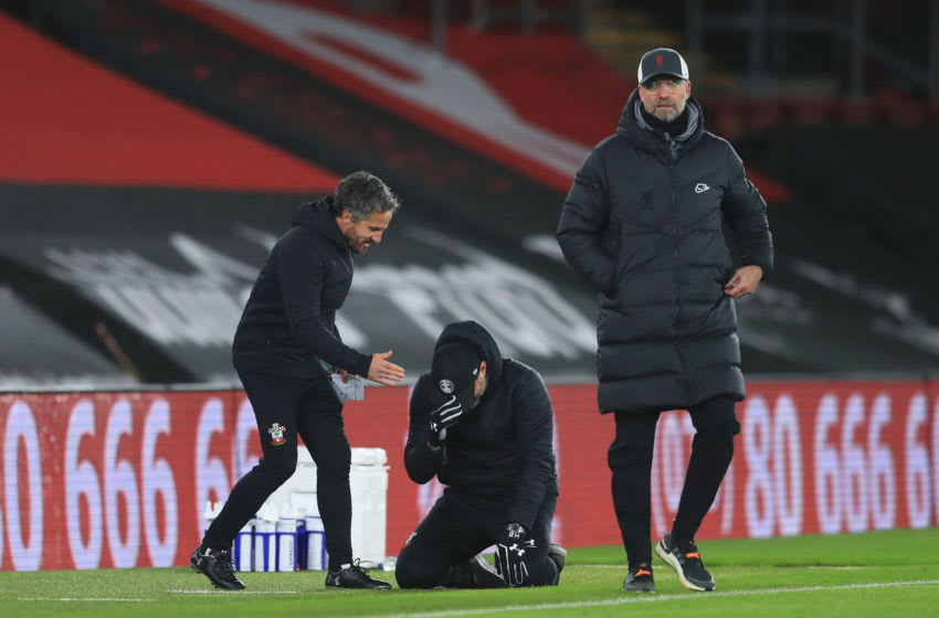 SOUTHAMPTON, ENGLAND - JANUARY 04: Ralph Hasenhuttl, Manager of Southampton celebrates victory with his assistant manager Richard Kitzbichler as Jurgen Klopp, Manager of Liverpool reacts after the Premier League match between Southampton and Liverpool at St Mary's Stadium on January 04, 2021 in Southampton, England. The match will be played without fans, behind closed doors as a Covid-19 precaution. (Photo by Adam Davy - Pool/Getty Images)