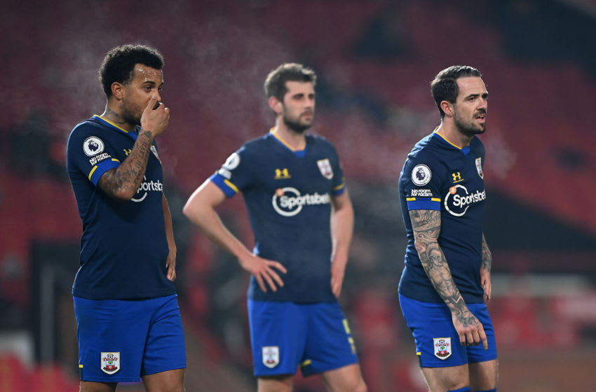 MANCHESTER, ENGLAND - FEBRUARY 02: (L-R) Ryan Bertrand, Jack Stephens and Danny Ings of Southampton show their disappointment during the Premier League match between Manchester United and Southampton at Old Trafford on February 02, 2021 in Manchester, England. Sporting stadiums around the UK remain under strict restrictions due to the Coronavirus Pandemic as Government social distancing laws prohibit fans inside venues resulting in games being played behind closed doors. (Photo by Laurence Griffiths/Getty Images)