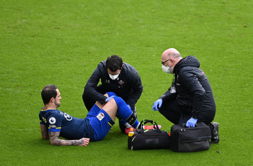 SHEFFIELD, ENGLAND - MARCH 06: Danny Ings of Southampton receives medical treatment during the Premier League match between Sheffield United and Southampton at Bramall Lane on March 06, 2021 in Sheffield, England. Sporting stadiums around the UK remain under strict restrictions due to the Coronavirus Pandemic as Government social distancing laws prohibit fans inside venues resulting in games being played behind closed doors. (Photo by Laurence Griffiths/Getty Images)