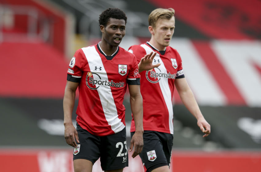 SOUTHAMPTON, ENGLAND - MARCH 14: Nathan Tella and James Ward-Prowse of Southampton during the Premier League match between Southampton and Brighton & Hove Albion at St Mary's Stadium on March 14, 2021 in Southampton, England. Sporting stadiums around the UK remain under strict restrictions due to the Coronavirus Pandemic as Government social distancing laws prohibit fans inside venues resulting in games being played behind closed doors. (Photo by Robin Jones/Getty Images)