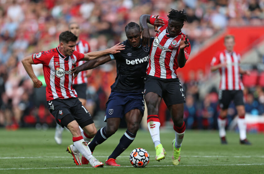 SOUTHAMPTON, ENGLAND - SEPTEMBER 11: Michail Antonio of West Ham United battles for possession with Jack Stephens and Mohammed Salisu of Southampton during the Premier League match between Southampton and West Ham United at St Mary's Stadium on September 11, 2021 in Southampton, England. (Photo by Steve Bardens/Getty Images)