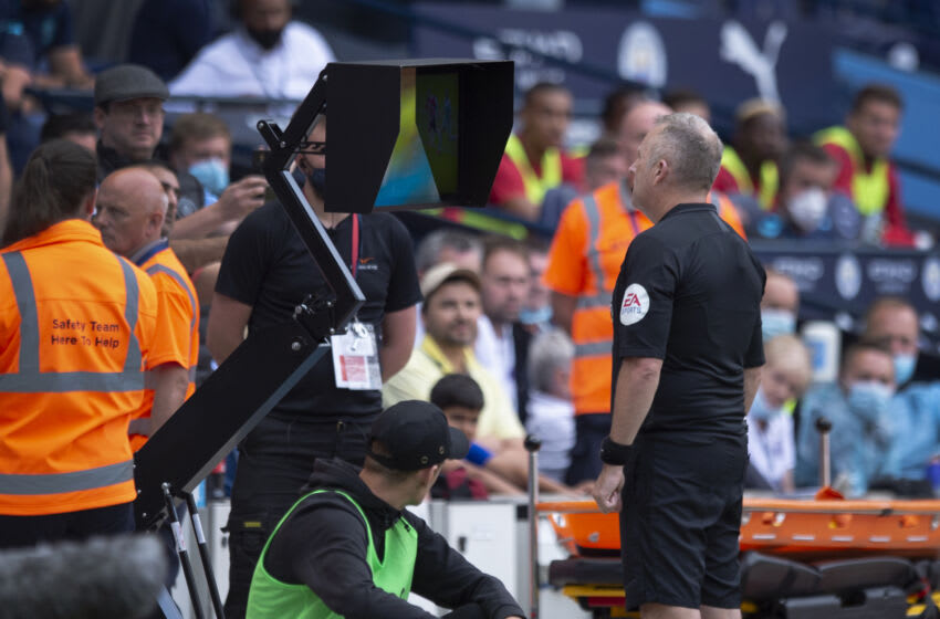 MANCHESTER, ENGLAND - SEPTEMBER 18: Referee Jonathan Moss goes over to the pitchside VAR screen to check his decision to award a penalty to Southampton and send off Kyle Walker of Manchester City during the Premier League match between Manchester City and Southampton at Etihad Stadium on September 18, 2021 in Manchester, England. (Photo by Joe Prior/Visionhaus)