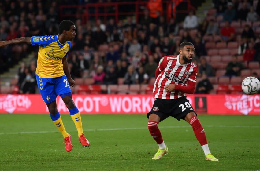 SHEFFIELD, ENGLAND - SEPTEMBER 21: Ibrahima Diallo of Southampton scores their team's first goal while Jayden Bogle of Sheffield United looks on during the Carabao Cup Third Round match between Sheffield United and Southampton at Bramall Lane on September 21, 2021 in Sheffield, England. (Photo by Laurence Griffiths/Getty Images)