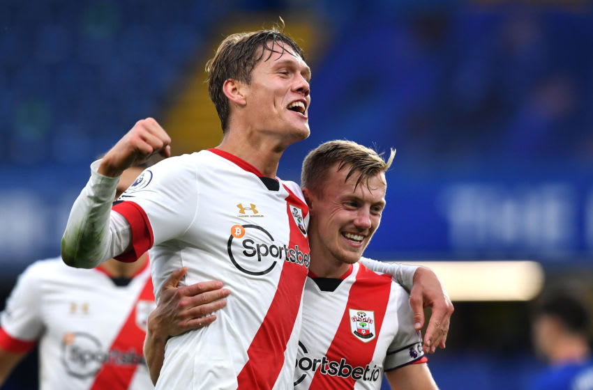 LONDON, ENGLAND - OCTOBER 17: Jannik Vestergaard of Southampton celebrates with teammate James Ward-Prowse after scoring his team's third goal during the Premier League match between Chelsea and Southampton at Stamford Bridge on October 17, 2020 in London, England. Sporting stadiums around the UK remain under strict restrictions due to the Coronavirus Pandemic as Government social distancing laws prohibit fans inside venues resulting in games being played behind closed doors. (Photo by Ben Stansall - Pool/Getty Images)