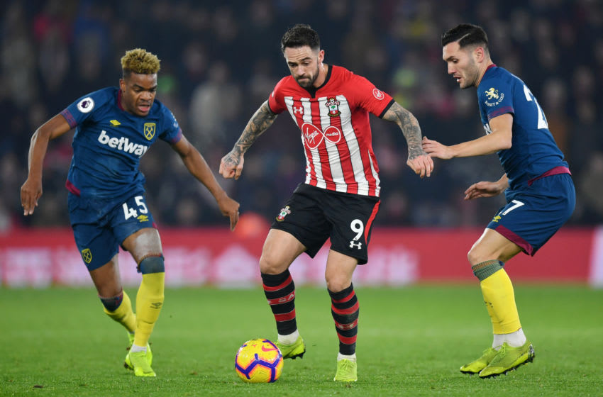 SOUTHAMPTON, ENGLAND - DECEMBER 27: Grady Diangana of West Ham United and Lucas Perez of West Ham United look on as Danny Ings of Southampton controls the ball during the Premier League match between Southampton FC and West Ham United at St Mary's Stadium on December 27, 2018 in Southampton, United Kingdom. (Photo by Dan Mullan/Getty Images)