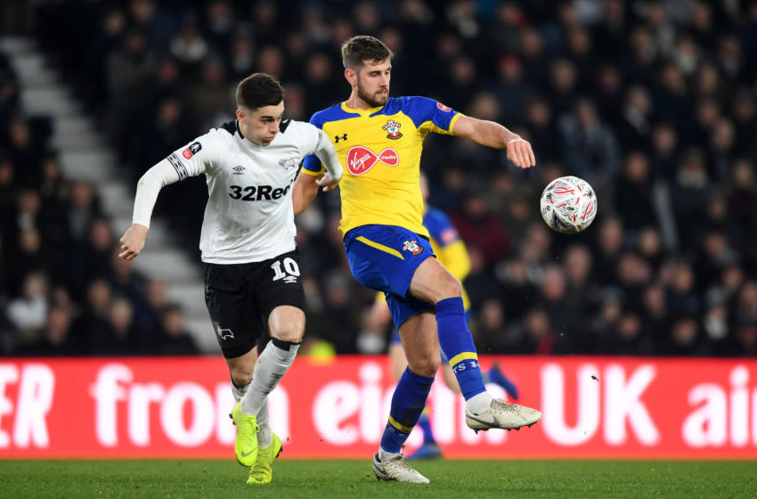 DERBY, ENGLAND - JANUARY 05: Jack Stephens of Southampton is challenged by Tom Lawrence of Derby County during the FA Cup Third Round match between Derby County and Southampton at Pride Park on January 5, 2019 in Derby, United Kingdom. (Photo by Michael Regan/Getty Images)