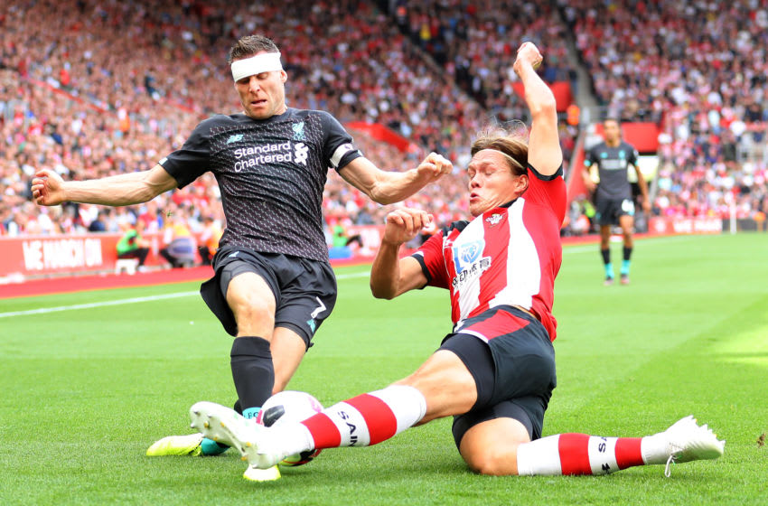 SOUTHAMPTON, ENGLAND - AUGUST 17: James Milner of Liverpool and Jannik Vestergaard of Southampton compete for the ball during the Premier League match between Southampton FC and Liverpool FC at St Mary's Stadium on August 17, 2019 in Southampton, United Kingdom. (Photo by Warren Little/Getty Images)