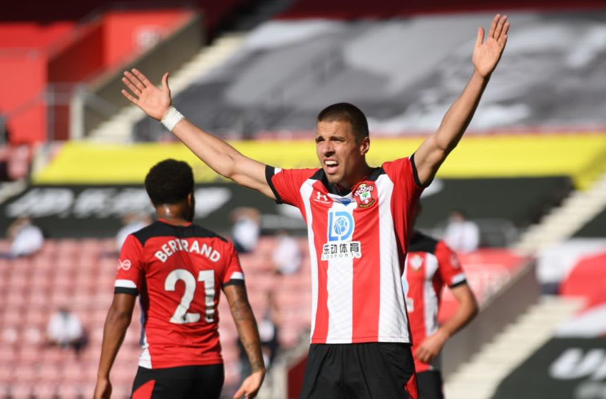 Southampton's Polish defender Jan Bednarek reacts during the English Premier League football match between Southampton and Arsenal at St Mary's Stadium in Southampton, southern England on June 25, 2020. (Photo by Mike Hewitt / POOL / AFP) / RESTRICTED TO EDITORIAL USE. No use with unauthorized audio, video, data, fixture lists, club/league logos or 'live' services. Online in-match use limited to 120 images. An additional 40 images may be used in extra time. No video emulation. Social media in-match use limited to 120 images. An additional 40 images may be used in extra time. No use in betting publications, games or single club/league/player publications. / (Photo by MIKE HEWITT/POOL/AFP via Getty Images)