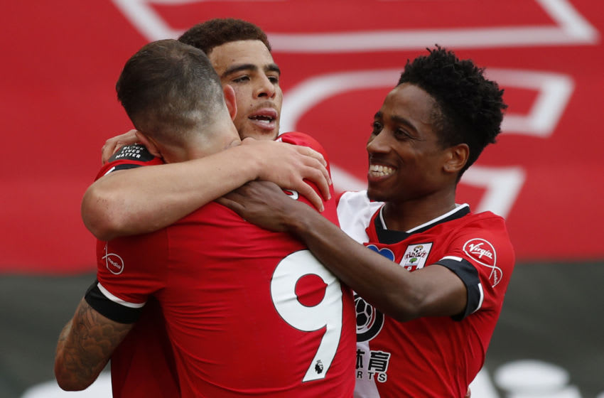 Southampton's English midfielder Che Adams celebrates with teammates after scoring during the English Premier League football match between Southampton and Sheffield United at St Mary's Stadium in Southampton, southern England on July 26, 2020. (Photo by ANDREW BOYERS / POOL / AFP) / RESTRICTED TO EDITORIAL USE. No use with unauthorized audio, video, data, fixture lists, club/league logos or 'live' services. Online in-match use limited to 120 images. An additional 40 images may be used in extra time. No video emulation. Social media in-match use limited to 120 images. An additional 40 images may be used in extra time. No use in betting publications, games or single club/league/player publications. / (Photo by ANDREW BOYERS/POOL/AFP via Getty Images)