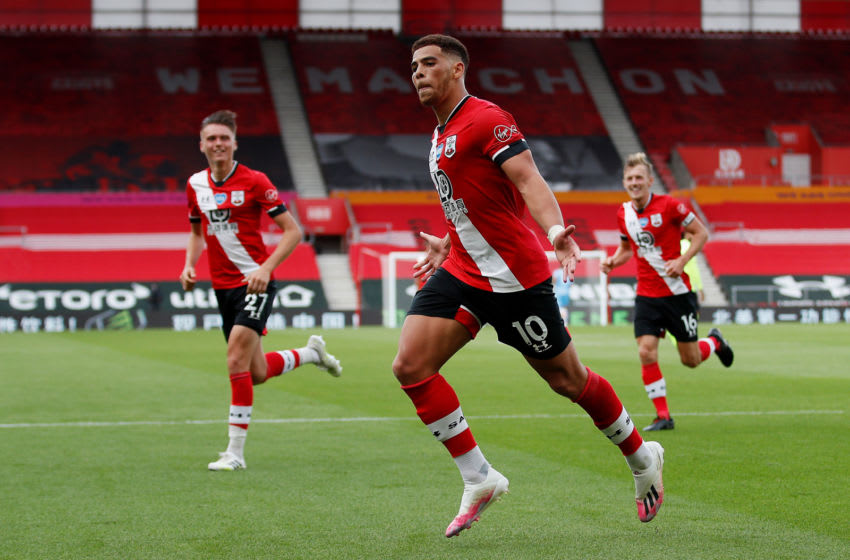 SOUTHAMPTON, ENGLAND - JULY 26: Che Adams of Southampton celebrates after scoring his team's second goal during the Premier League match between Southampton FC and Sheffield United at St Mary's Stadium on July 26, 2020 in Southampton, England. Football Stadiums around Europe remain empty due to the Coronavirus Pandemic as Government social distancing laws prohibit fans inside venues resulting in all fixtures being played behind closed doors. (Photo by Andrew Boyers/Pool via Getty Images)