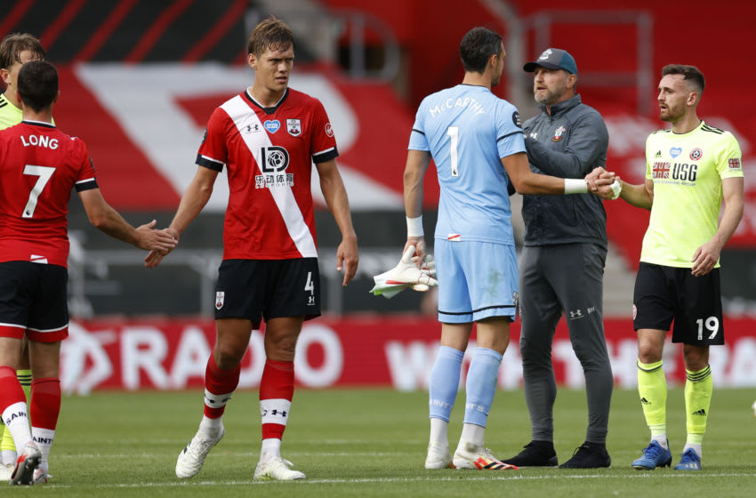 SOUTHAMPTON, ENGLAND - JULY 26: Ralph Hasenhuttl, Manager of Southampton celebrates with Alex McCarthy after the Premier League match between Southampton FC and Sheffield United at St Mary's Stadium on July 26, 2020 in Southampton, England. Football Stadiums around Europe remain empty due to the Coronavirus Pandemic as Government social distancing laws prohibit fans inside venues resulting in all fixtures being played behind closed doors. (Photo by Andrew Boyers/Pool via Getty Images)