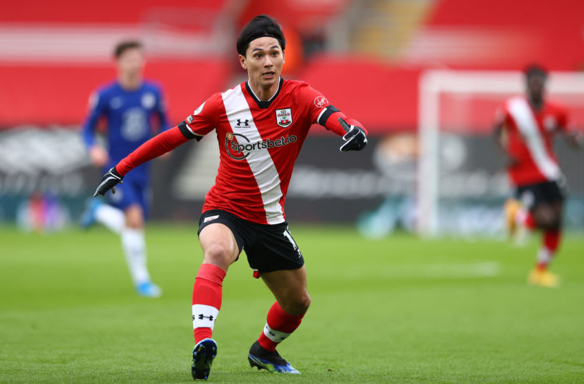 SOUTHAMPTON, ENGLAND - FEBRUARY 20: Takumi Minamino of Southampton during the Premier League match between Southampton and Chelsea at St Mary's Stadium on February 20, 2021 in Southampton, England. Sporting stadiums around the UK remain under strict restrictions due to the Coronavirus Pandemic as Government social distancing laws prohibit fans inside venues resulting in games being played behind closed doors. (Photo by Michael Steele/Getty Images)