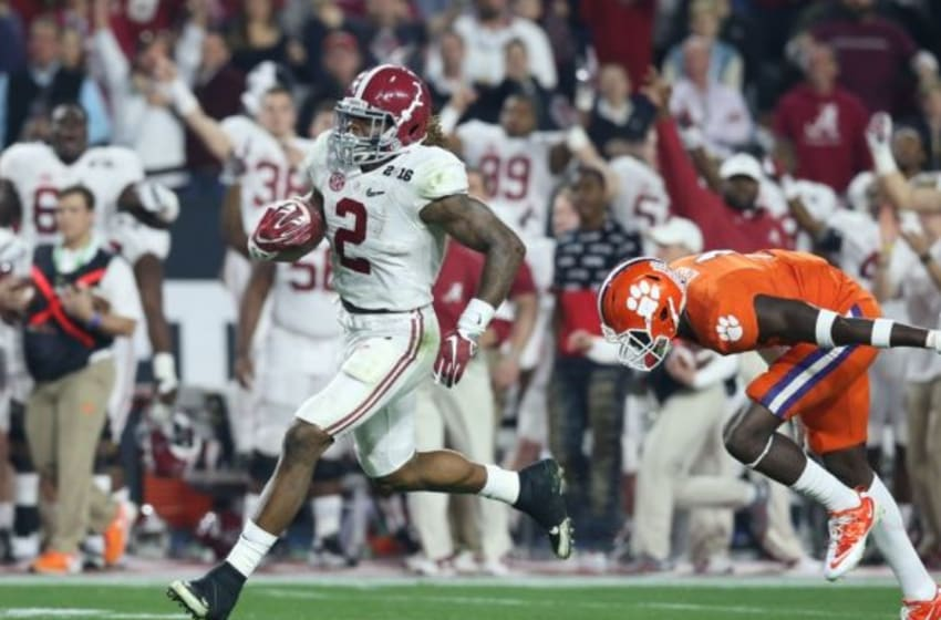 Jan 11, 2016; Glendale, AZ, USA; Alabama Crimson Tide running back Derrick Henry (2) carries the ball past Clemson Tigers safety Jayron Kearse (1) on a 50 yard touchdown run during the first quarter in the 2016 CFP National Championship at University of Phoenix Stadium. Mandatory Credit: Matthew Emmons-USA TODAY Sports