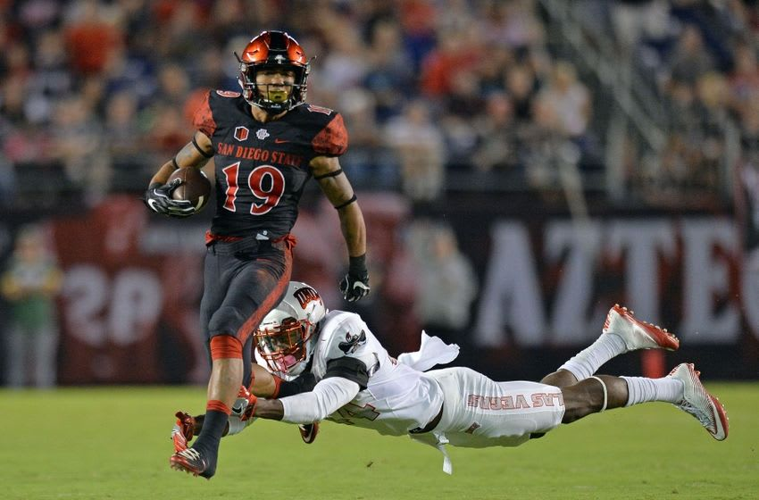 Oct 8, 2016; San Diego, CA, USA; San Diego State Aztecs running back Donnel Pumphrey (19) runs the ball as UNLV Rebels defensive back Kenny Keys (44) dives for him during the first quarter at Qualcomm Stadium. Mandatory Credit: Jake Roth-USA TODAY Sports