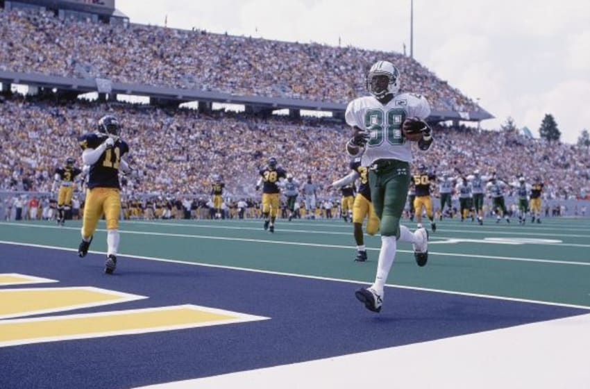 College Football: Marshall Randy Moss (88) in action, running into endzone for touchdow vs West Virginia at Mountaineer Field. Morgantown, WV 8/30/1997 CREDIT: Al Tielemans (Photo by Al Tielemans /Sports Illustrated/Getty Images) (Set Number: X53411 TK3 R4 F15 )