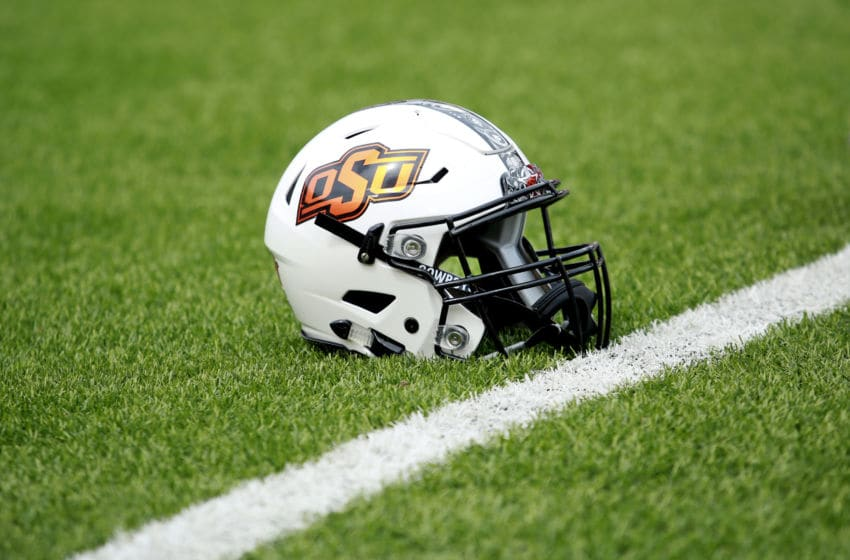 STILLWATER, OK - SEPTEMBER 15: A Oklahoma State Cowboys helmet on the field during warm ups before the game against the Boise State Broncos at Boone Pickens Stadium on September 15, 2018 in Stillwater, Oklahoma. The Cowboys defeated the Broncos 44-21. (Photo by Brett Deering/Getty Images)