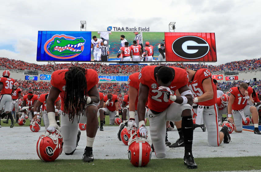 JACKSONVILLE, FL - OCTOBER 27: The Georgia Bulldogs take a knee during a game against the Florida Gators at TIAA Bank Field on October 27, 2018 in Jacksonville, Florida. (Photo by Mike Ehrmann/Getty Images)