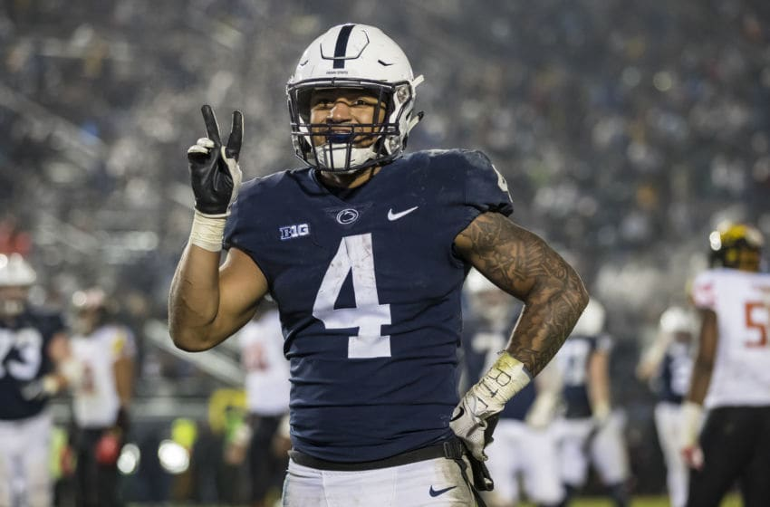 STATE COLLEGE, PA - NOVEMBER 24: Ricky Slade #4 of the Penn State Nittany Lions reacts after scoring his second touchdown against the Maryland Terrapins during the second half at Beaver Stadium on November 24, 2018 in State College, Pennsylvania. (Photo by Scott Taetsch/Getty Images)