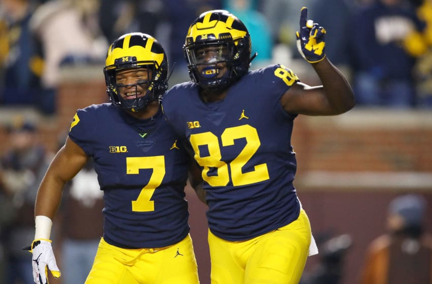 ANN ARBOR, MICHIGAN - NOVEMBER 17: Nick Eubanks #82 of the Michigan Wolverines celebrates a first half touchdown with Tarik Black #7 while playing the Indiana Hoosiers at Michigan Stadium on November 17, 2018 in Ann Arbor, Michigan. (Photo by Gregory Shamus/Getty Images)
