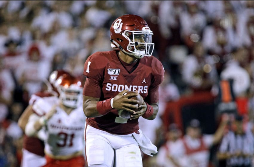 NORMAN, OK - SEPTEMBER 1: Quarterback Jalen Hurts #1 of the Oklahoma Sooners runs in the backfield against the Houston Cougars at Gaylord Family Oklahoma Memorial Stadium on September 1, 2019 in Norman, Oklahoma. The Sooners defeated the Cougars 49-31. (Photo by Brett Deering/Getty Images)