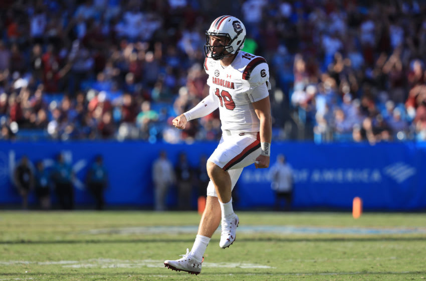 CHARLOTTE, NORTH CAROLINA - AUGUST 31: Jake Bentley #19 of the South Carolina Gamecocks reacts after his team scores a touchdown against the North Carolina Tar Heels during the Belk College Kickoff game at Bank of America Stadium on August 31, 2019 in Charlotte, North Carolina. (Photo by Streeter Lecka/Getty Images)