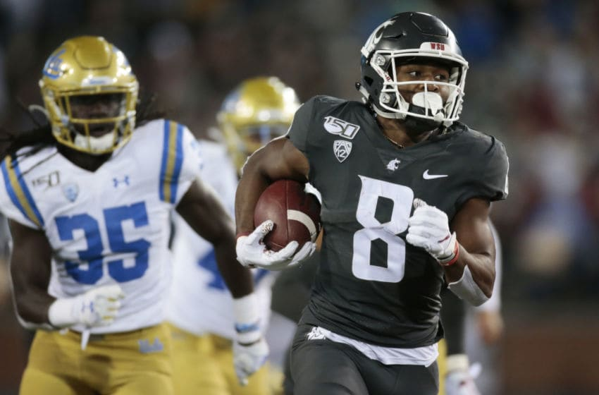 PULLMAN, WASHINGTON - SEPTEMBER 21: Easop Winston Jr. #8 of the Washington State Cougars carries the ball against the UCLA Bruins in the second half at Martin Stadium on September 21, 2019 in Pullman, Washington. UCLA defeats Washington State 67-63. (Photo by William Mancebo/Getty Images)